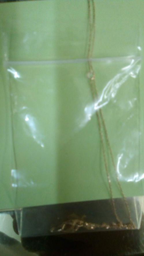 袋にチェーンの長さ3/4くらいを入れ、袋の入り口にひっかける
